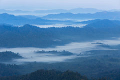 High angle view over tropical mountains with white fog in early morning Stock Photo