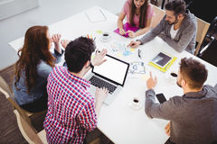 High angle view of partners discussing in meeting room at creative office Stock Images