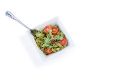 High angle view of pasta salad in bowl with fork Stock Photo