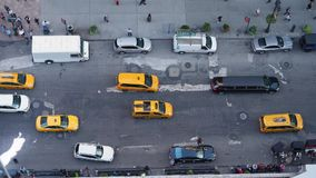 View High Angle View of Traffic and Pedestrians on 5th Avenue in Manhattan. A high angle view of pedestrians and traffic on 5th Avenue in midtown Manhattan stock video