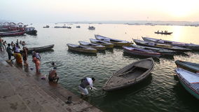 High angle view of people and boats in Ganges river in Varanasi. stock video footage