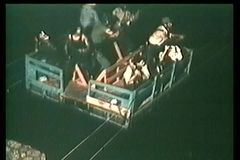 High angle view people escaping across river on raft stock video footage
