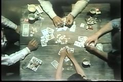 High angle view of people playing cards on wooden table stock video footage
