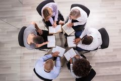 People Sitting In A Circle Reading Bible royalty free stock photography