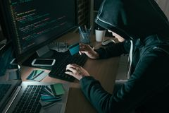 High angle view photo of hacker using computer. Online system stolen brushing credit card stock photography
