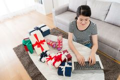 High angle view photo of smiling pretty woman. High angle view photo of smiling pretty women using mobile computer online shopping at home and choosing gift Royalty Free Stock Photos