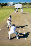 High angle view of players at cricket match. On sunny day royalty free stock photos