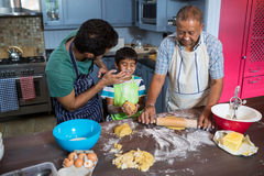 High angle view of playful family preparing food. In kitchen at home Stock Image