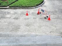 Portable Metal Fence and Traffic Road Cones. High Angle View of Portable Metal Fence and Traffic Road Cones royalty free stock images