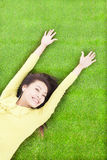 High angle view of  pretty  woman relaxing and lying. On grass Royalty Free Stock Photo