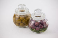 High angle view red and green olives in glass jar Stock Photo