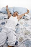 High angle view of resting man stretching his arms Stock Photos
