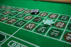 High angle view of ring and chips on roulette table. At casino Stock Photo