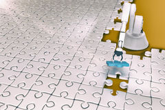 High angle view of robot setting up jigsaw 3d Stock Photos