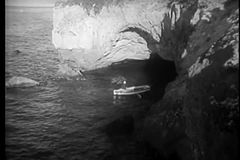 High angle view of row boat leaving grotto stock footage