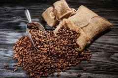 high angle view of sacks of coffee beans and scoop on rustic stock images