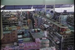 High angle view of security guard walking through store stock video footage