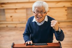 Asian man celebrating victory Stock Photography