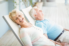 High angle view of senior couple relaxing on lounge chair Stock Images