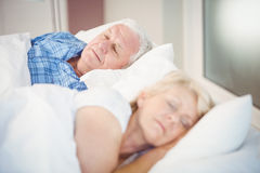 High angle view of senior couple sleeping on bed Stock Images