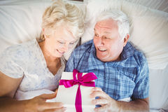 High angle view of senior man giving wife gift Stock Photography