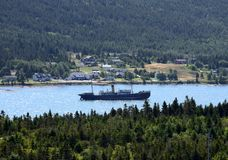 Above water shipwreck at Harbour Grace, NL Canada. High angle view of the shipwreck of the SS Kyle located at Harbour Grace, 102 year-old ship has been grounded stock photos