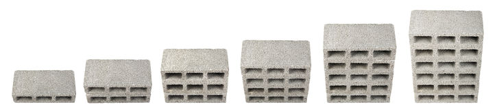 Construction Blocks Chart. High angle view six gray concrete construction blocks (a.k.a. cinder block, breeze block, cement block, foundation block, besser block royalty free stock photo