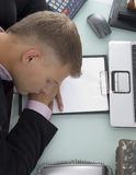 High angle view of sleeping young lawyer Royalty Free Stock Photography