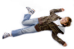 High angle view of small kid lying down on floor Stock Images
