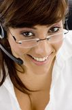 High angle view of smiling female with headset Royalty Free Stock Photo