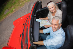 High angle view of smiling mature man having a ride with his wif Stock Image