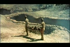 High angle view of soldiers carrying wounded man on stretcher stock video