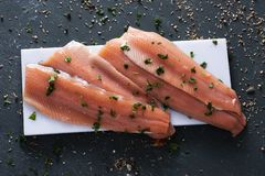 Slices of raw trout Stock Photo