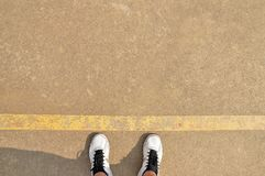 Ready to play. High angle view of sport shoes on the cement playground with copyspace Stock Photography