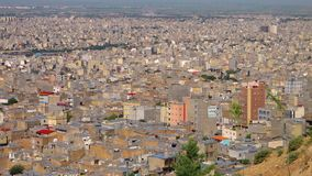 High angle view of sprawling Tabriz. High angle view of the sprawling city of Tabriz, Iran. Large apartment blocks cover the plains at the foot of the desert stock video