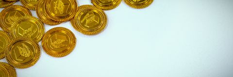 High angle view of St Patricks Day gold coin chocolates. On white background Stock Photography