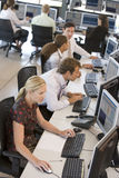 High Angle View Of Stock Traders At Work Royalty Free Stock Photography