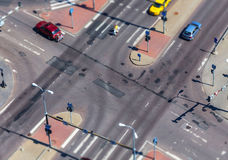 High angle view of a street intersection. With cross walk markings, traffic signal lights - tilt shift Royalty Free Stock Images