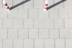 High angle view of striped poles on sidewalk Stock Images