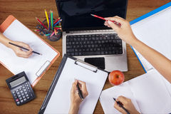 High angle view of student hands 3 Stock Photo
