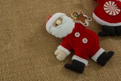 High angle view of stuffed santa claus. On burlap stock images