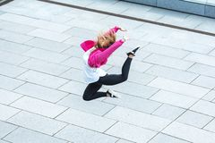 high angle view of stylish female urban dancer jumping royalty free stock photography