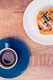 High angle view of sweet food served in plate by coffee cup on table. At office Stock Photo