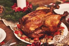 High angle view of table served for Christmas family dinner. Tab Stock Photo