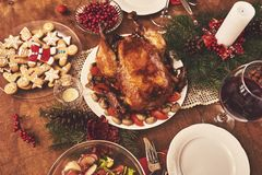 High angle view of table served for Christmas family dinner. Tab stock image