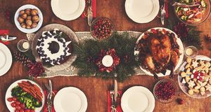 High angle view of table served for Christmas family dinner. Tab stock photography