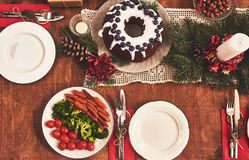 High angle view of table served for Christmas family dinner. Tab royalty free stock image