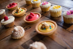 High angle view of tart and cupcakes arranged on table. At cafe shop Stock Photo