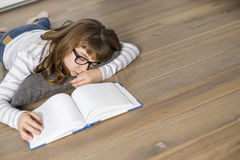 High angle view of teenage girl sleeping while studying on floor Royalty Free Stock Images