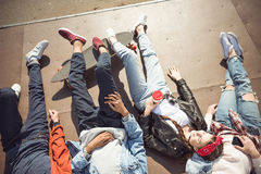 High angle view of teenagers group lying together and resting Stock Image